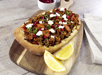 Turkish flatbread with beef, red onion, feta and pomegranate